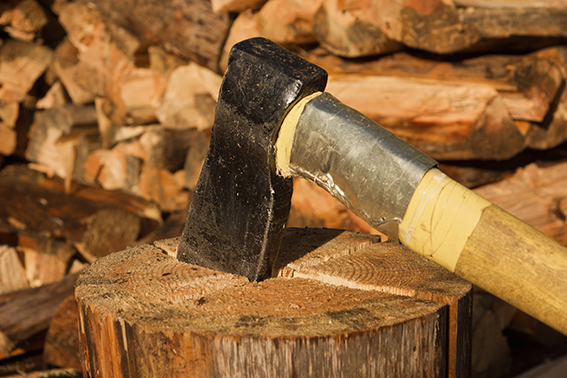 Axe in log on a firewoods background